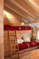 The attic bedroom is furnished with contemporary bunk beds