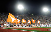Jan 7, 2010; Pasadena, CA, USA; Texas Longhorns cheerleaders run along the sideline with flags spelling out Texas during the 2010 BCS national championship game against the Alabama Crimson Tide at the Rose Bowl. Alabama defeated Texas 37-21. Mandatory Credit: Mark J. Rebilas-.