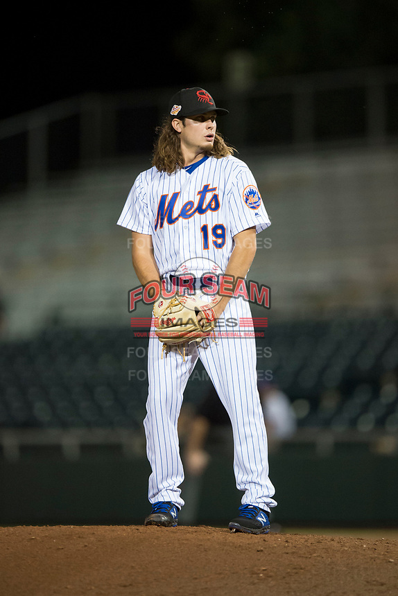 Scottsdale Scorpions relief pitcher Matt Blackham (19), of the New York Mets organization, gets ready to deliver a pitch during an Arizona Fall League game against the Mesa Solar Sox on October 9, 2018 at Scottsdale Stadium in Scottsdale, Arizona. The Solar Sox defeated the Scorpions 4-3. (Zachary Lucy/Four Seam Images)