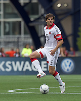 DC United defender Dejan Jakovic (5) traps the ball. In a Major League Soccer (MLS) match, DC United defeated the New England Revolution, 2-1, at Gillette Stadium on April 14, 2012.