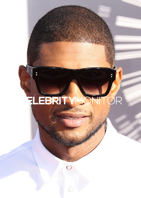 LOS ANGELES, CA, USA - AUGUST 24: Usher at the 2014 MTV Video Music Awards held at The Forum on August 24, 2014 in the Los Angeles, California, United States. (Photo by Xavier Collin/Celebrity Monitor)