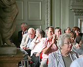 Audience applauding a performance by Martin Taylor, solo jazz guitarist at Petworth House, Petworth Festival, West Sussex.