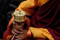 Novice Buddhist Monk and his Prayer Wheel,Tibet.