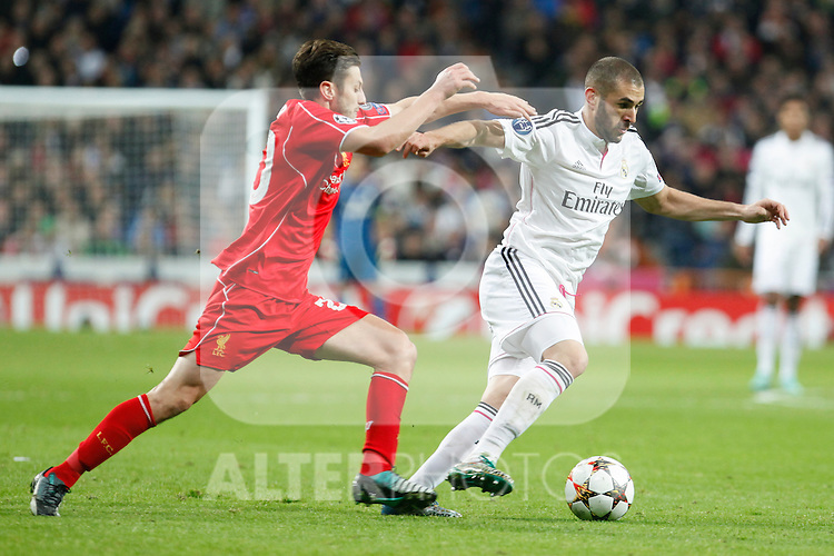 Real Madrid´s Karim Benzema (R) and Liverpool´s Adam Lallana during Champions League soccer match between Real Madrid and Liverpool at Santiago Bernabeu stadium in Madrid, Spain. November 04, 2014. (ALTERPHOTOS/Victor Blanco)