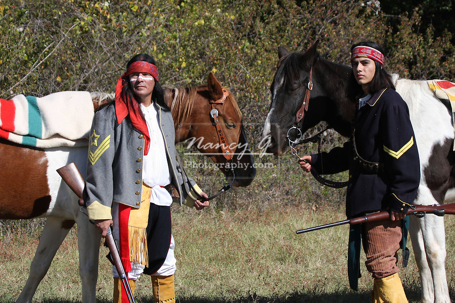 Two Apache Native American Indians with their horses