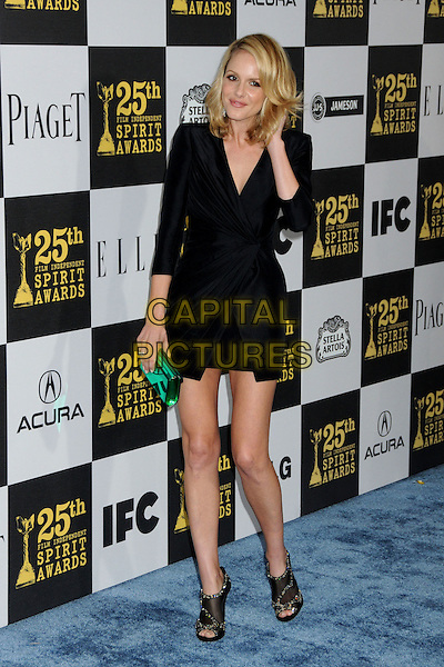 MONET MAZUR .25th Annual Film Independent Spirit Awards - Arrivals held at the Nokia Event Deck at L.A. Live, Los Angeles, California, USA..March 5th, 2010.full length black wrap dress green clutch bag ankle boots shoes booties mesh.CAP/ADM/BP.©Byron Purvis/AdMedia/Capital Pictures.