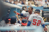 Apr 17, 1988 - LOS ANGELES, California, USA - Atlanta Braves' centerfielder Albert Hall gets a high five from teammates as he enters the dugout after scoring to give Atlanta a 3-1 lead in the eighth inning over the Los Angeles Dodgers, at Dodgers Stadium, April 17, 1988. .(Credit Image: © Alan Greth)