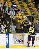 Stephane Da Costa (Merrimack - 24) tosses his stick to a fan. - The Merrimack College Warriors defeated the University of New Hampshire Wildcats 4-1 (EN) in their Hockey East Semi-Final on Friday, March 18, 2011, at TD Garden in Boston, Massachusetts.