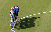 The Wycombe players join in a minutes silence in memory of those who lose there lives i the Brussels attack earlier in the week during the Sky Bet League 2 match between Wycombe Wanderers and Mansfield Town at Adams Park, High Wycombe, England on 25 March 2016. Photo by Andy Rowland.