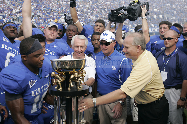 UK receives the Governor's Cup Trophy after their 31-27 win over Louisville on Saturday, Sept. 19, 2009 Photo by Adam Wolffbrandt | Staff