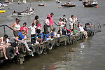 People crabbing from a jetty on the River Deben at Felixstowe Ferry, Suffolk, England