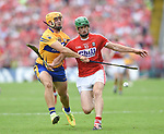 Jason Mc Carthy of Clare in action against Seamus Harnedy of Cork during their Munster senior hurling final at Thurles. Photograph by John Kelly.