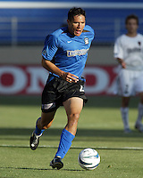 Brian Ching in action during an MLS match between the San Jose Earthquakes and MetroStars on June 13, 2004 in San Jose, California.  San Jose defeated the MetroStars 3-1.