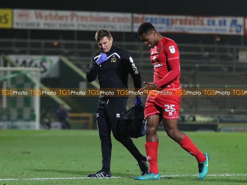 Chuks Aneke of MK Dons leaves the field of play after receiving an injury during Yeovil Town vs MK Dons, Checkatrade Trophy Football at Huish Park on 6th December 2016