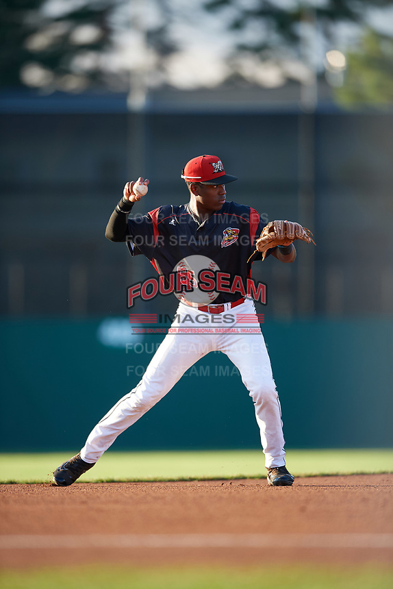 Batavia Muckdogs shortstop Demetrius Sims (55) warmup throw to first base during a game against the Mahoning Valley Scrappers on August 18, 2017 at Dwyer Stadium in Batavia, New York.  Mahoning Valley defeated Batavia 8-2.  (Mike Janes/Four Seam Images)