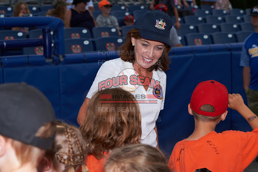 Lieutenant Governor Kathy Hochul talks with Oakfield-Alabama little leaguers before throwing out a ceremonial first pitch at a Batavia Muckdogs game against the Auburn Doubledays on July 6, 2017 at Dwyer Stadium in Batavia, New York.  Auburn defeated Batavia 4-3.  (Mike Janes/Four Seam Images)