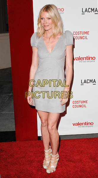 "GWYNETH PALTROW .The West Coast premiere of ""Valentino: The Last Emperor"" at the Los Angeles County Museum of Art (LACMA), Los Angeles, California, USA..April 1st, 2009.full length grey gray dress beige ankle strappy sandals shoes .CAP/ROT.©Lee Roth/Roth Stock/Capital Pictures"