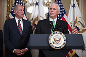 United States Vice President Mike Pence (R), with Director of National Intelligence Dan Coats (L), delivers remarks during a swearing in ceremony in the US Capitol in Washington, DC, USA, 16 March 2017.<br /> Credit: Shawn Thew / Pool via CNP