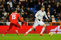 Real Madrid´s Karim Benzema and Sevilla's Timothee Kolodziejczak during 2014-15 La Liga match between Real Madrid and Sevilla at Santiago Bernabeu stadium in Alcorcon, Madrid, Spain. February 04, 2015. (ALTERPHOTOS/Luis Fernandez) /NORTEphoto.com