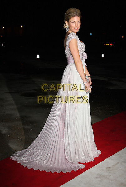 HOFIT GOLAN.Grey Goose Character and Cocktails: Elton John AIDS Foundation Winter Ball, Grey Goose Maison de Mode, London, England, UK, October 30th 2010. .full length white silver pleated dress long maxi pink bow beaded clutch bag grey gray side back over shoulder .CAP/ROS.©Steve Ross/Capital Pictures