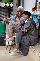 Rissani, Morocco.  Market, Two Middle-aged Men Sitting Together.