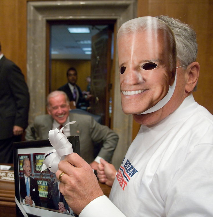 "WASHINGTON, DC - Oct. 31: Sen. Chuck Hagel, R-Neb., pokes Halloween fun at Chairman Joseph R. Biden Jr., D-Del., left, by wearing a Biden mask and a ""Joseph Biden for President"" sweat shirt before the Foreign Relations markup of several treaties and a resolution regarding the degradation of the Jordan River and the Dead Sea, and urging cooperation between Israel, Jordan and Palestine. (Photo by Scott J. Ferrell/Congressional Quarterly)."