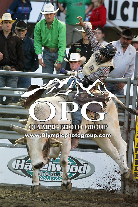 20 Aug 2014:  Cain Smith scored a 79.5 while competing in the Seminole Hard Rock Extreme Bulls competition at the Kitsap County Stampede in Bremerton, Washington.