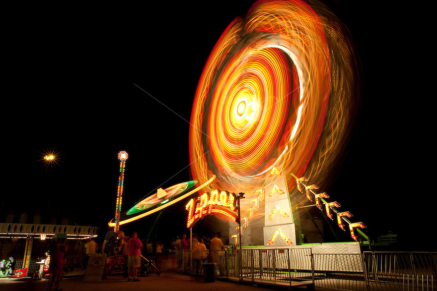 carnival rides spinning, night, low angle view (long exposure) austin, texas