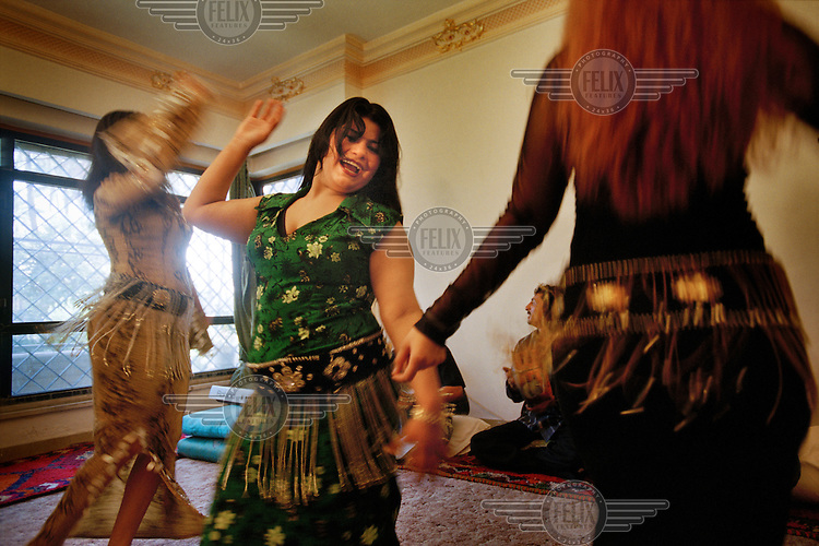 Kawaleya, 'dancing girls', performing at a private residence in al Adamiya district. Most of the dancers are also prostitutes.