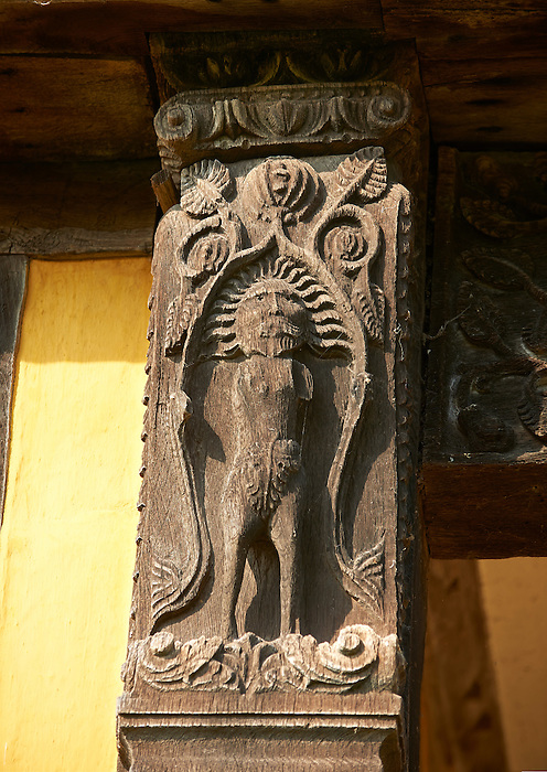 Medieval wood carving of Adam on the gate house of the  finest fortified medieval manor house in England built in the 1280s, Stokesay Castle, Shropshire, England