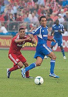 03 July 2013: Toronto FC midfielder Luis Silva #11 and Montreal Impact defender Alessandro Nesta #14 in action during an MLS game between the Montreal Impact and Toronto FC at BMO Field in Toronto, Ontario Canada.