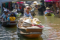Hat seller in the Damnern Saduak floating market, Bankok, Thailand