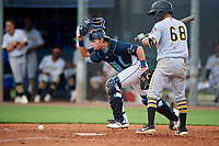 GCL Rays catcher Dawson Dimon (14) checks the base runner after blocking a pitch in the dirt as Andres Alvarez (68) bats during a Gulf Coast League game against the GCL Pirates on August 7, 2019 at Charlotte Sports Park in Port Charlotte, Florida.  GCL Rays defeated the GCL Pirates 5-3 in the second game of a doubleheader.  (Mike Janes/Four Seam Images)