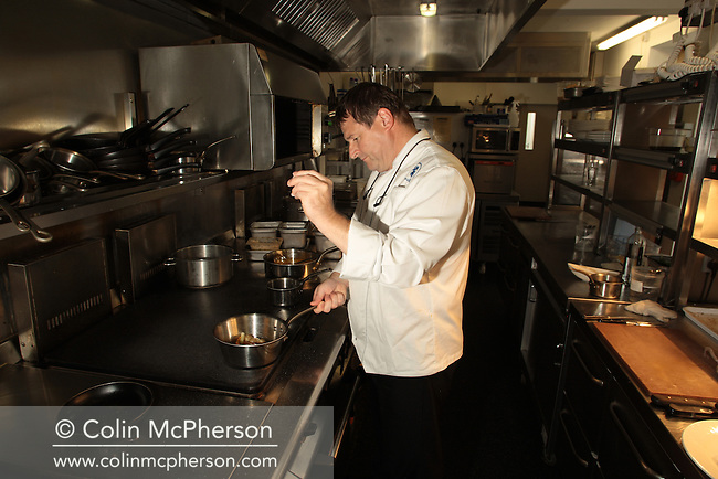 Award-winning chef Robert Kisby, pictured working in the kitchen of the restaurant of the Cock O' Barton in Malpas, Cheshire, northwest England. Mr Kisby left his job in April 2008 to pursue other business interests.