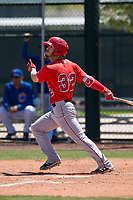 Los Angeles Angels outfielder Orlando Martinez (32) follows through on his swing during an Extended Spring Training game against the Chicago Cubs at Sloan Park on April 14, 2018 in Mesa, Arizona. (Zachary Lucy/Four Seam Images)