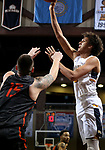 SIOUX FALLS, SD - MARCH 9:  Reginald Kissoonlal #5 from Marian shoots over the defense of Scott Schwieterman #15 from Indiana Tech during their second round game at the 2018 NAIA DII Men's Basketball Championship at the Sanford Pentagon in Sioux Falls. (Photo by Dave Eggen/Inertia)