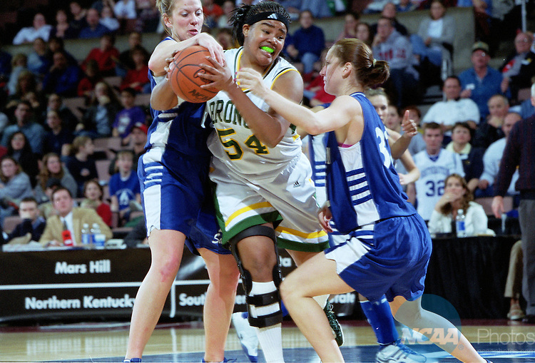 23 MAR 2002:  L to R forward Tera Newnam (11) of Southeastern Oklahoma State University, center Aprile Powell (54) of Cal Poly Pomona and forward Katy Morrow-Korstjens (32) of SOSU, during the NCAA Division 2 Women's Basketball Championship held at the Mayo Civic Center in Rochester, Minnesota, hosted by Winona State University. Cal Poly Pomona defeated Southeastern Oklahoma State University 74-62 for the Championship title for the second straight year. Jerry Olson/NCAA Photos