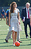 """CATHERINE, DUCHESS OF CAMBRIDGE HAS  A KICK-A-BOUT.After a bit of coxing Kate decided to have a go at kicking a football..But with the first attempt seeeing the ball hardly travel, she decided to have another go with guidance from hubby Prince William..The second attempt saw the ball go further. The Prince himself at earlier had an attempt at goal. The royal couple were joined by Prince Harry at Bacon's College, South London for the sports-themed event, to launch the Coach Core programme, a partnership bewteen their Foundation and Greenhouse_19/07/2012.Mandatory credit photo: ©Dias/DIASIMAGES..(Failure to credit will incur a surcharge of 100% of reproduction fees)..                **ALL FEES PAYABLE TO: """"NEWSPIX INTERNATIONAL""""**..IMMEDIATE CONFIRMATION OF USAGE REQUIRED:.DiasImages, 31a Chinnery Hill, Bishop's Stortford, ENGLAND CM23 3PS.Tel:+441279 324672  ; Fax: +441279656877.Mobile:  07775681153.e-mail: info@newspixinternational.co.uk"""