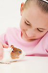 USA, Illinois, Metamora, Portrait of girl (10-11) with guinea pig