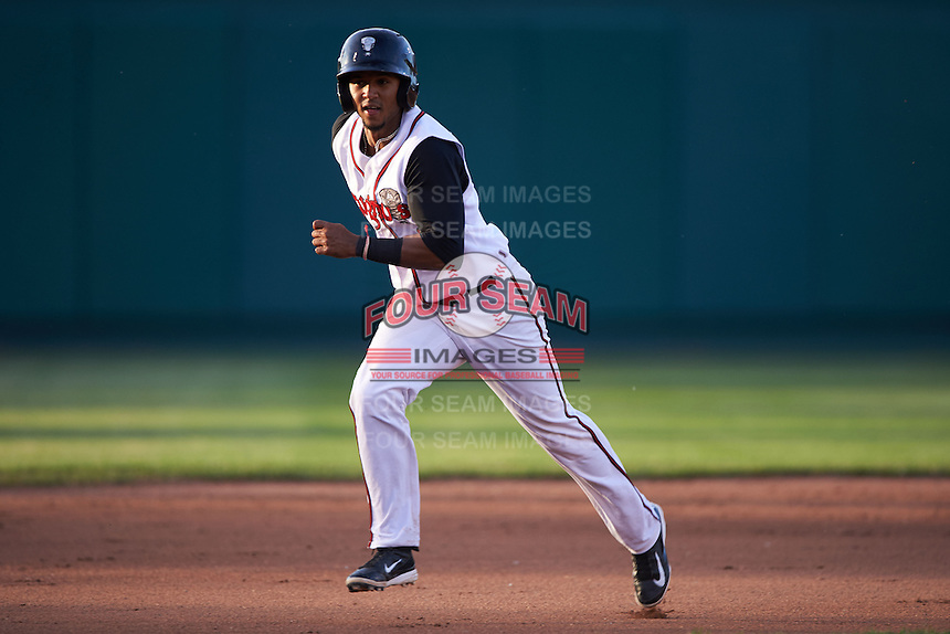 Lansing Lugnuts shortstop Richard Urena (1) running the bases during a game against the Peoria Chiefs on June 6, 2015 at Cooley Law School Stadium in Lansing, Michigan.  Lansing defeated Peoria 6-2.  (Mike Janes/Four Seam Images)