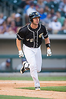 Matt Davidson (22) of the Charlotte Knights hustles down the first base line against the Columbus Clippers at BB&T BallPark on May 27, 2015 in Charlotte, North Carolina.  The Clippers defeated the Knights 9-3.  (Brian Westerholt/Four Seam Images)
