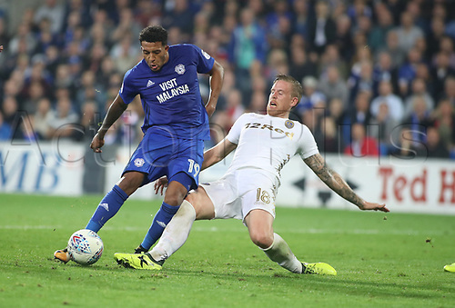 26th September 2017, Cardiff City Stadium, Cardiff, Wales; EFL Championship football, Cardiff City versus Leeds United; Nathaniel Mendez-Laing of Cardiff City gets a shot off but the pressure from Pontus Jansson of Leeds United causes it to go wide