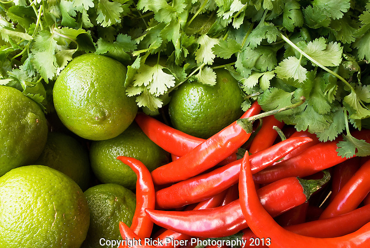 Chillies And Limes - Red chillies, limes and fresh coriander
