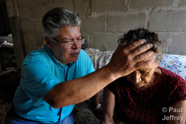 The Rev. JosŽ Roberto Pe–a-Nazario is a United Methodist missionary in Danli, Honduras. Here he prays with Olimpia Garcia, a member of his congregation.