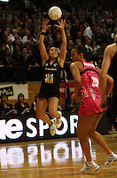 Liana Barrett-Chase leaps to take a pass during the International  Netball Series match between the NZ Silver Ferns and World 7 at TSB Bank Arena, Wellington, New Zealand on Monday, 24 August 2009. Photo: Dave Lintott / lintottphoto.co.nz