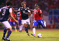 SAN JOSE, COSTA RICA - September 06, 2013: Jermaine Jones (13) of the USA MNT closes in to try and stop a shot by Joel Campbell (12) of the Costa Rica MNT during a 2014 World Cup qualifying match at the National Stadium in San Jose on September 6. USA lost 3-1.