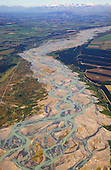 Aerial view of the braided Waimakariri river as it crosses the Canterbury plains with the Southern Alps in the distance,  Waimakariri District, Canterbury, South Island, New Zealand.