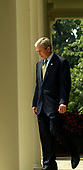 United States President George W. Bush walks from the Oval Office to the Rose Garden to make an announcement on the resignation of Justice Sandra Day O'Connor on July 1, 2005.   <br /> Credit: Dennis Brack - Pool via CNP