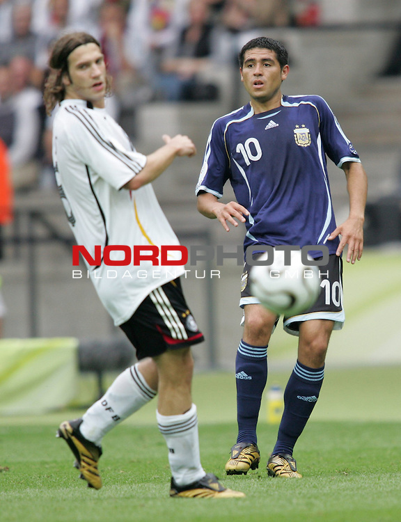 FIFA WM 2006 - Quarter-finals / Viertelfinale<br /> Play #57 (30-Jun) - Germany vs Argentina.<br /> Torsten Frings (l) from Germany and Juan Riquelme (r) from Argentina fight for the ball during the match of the World Cup in Berlin.<br /> Foto &copy; nordphoto