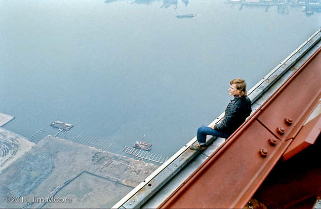 Philippe Petit sitting on edge of North Tower WTC.